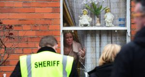 Nadia Hattaoui resists an attempt to evict herself her mother in Dublin yesterday. Photograph: Alan Betson