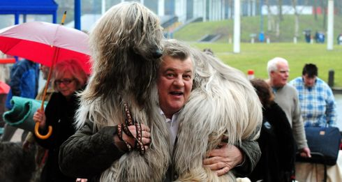 Dominico Traversri arrives with his Afghan dog Louis on the first day of Crufts 2013 at the NEC, Birmingham. PRESS ASSOCIATION Photo. Picture date: Thursday March 7, 2013. See PA story ANIMALS Crufts. Photo credit should read: Rui Vieira/PA Wire
