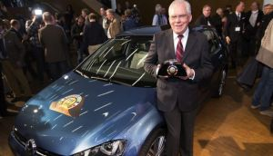 Ulrich Hackenberg of VW with the Car of the Year award for the Golf.