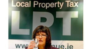 "Josephine Feehily, the chairwoman of the Revenue Commissioners, at yesterday's briefing on the local property tax. Ms Feehily said she would be disappointed if Revenue did not achieve a compliance level of ""several percentage points north of 80 per cent"" by the end of the year. photograph: david sleator"