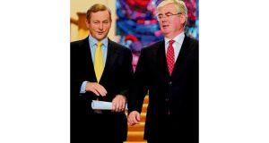 Taoiseach Enda Kenny and Tánaiste Eamon Gilmore at a press conference in Government Buildings in Dublin on June 16th, 2011, to mark the 100th day of the Fine Gael- Labour Coalition.