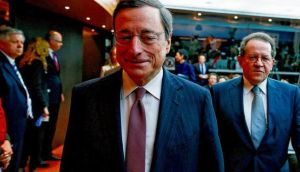 European Central Bank president Mario Draghi and vice-president Vitor Constancio (right) at the bank's headquarters in Frankfurt, Germany, yesterday. Mr Draghi stuck to his view that the euro area economy would gradually recover later this year. photograph: ralph orlowski/bloomberg