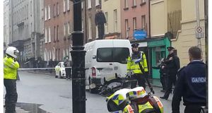 A man stands on the roof of a van outside Leinster House on Kildare Street.  Photograph: Mary Minihan/The Irish Times