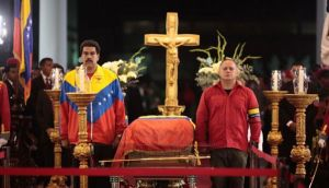 Venezuela's vice president Nicolas Maduro and National Assembly president Diosdado Cabello stand guard next to the coffin of late Venezuelan president Hugo Chavez during a wake in Caracas yesterday. Photograph: Miraflores Palace/Reuters