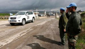 India's United Nations peacekeepers salute as a UN vehicle crosses from Syria into Israel at the Kuneitra border crossing on the Golan Heights yesterday. Photograph: Baz Ratner/Reuters