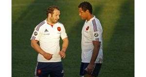 France's Thierry Dusautoir (right) speaks to team-mate Frederic Michalak at a training session at the Rugby Union National Centre in Marcoussis, south of Paris. Photograph: Charles Platiau/Reuters