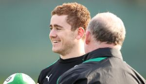 Paddy Jackson and Declan Kidney share a joke during training this week. Photograph: Billy Stickland/Inpho