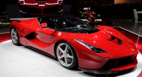 The new LaFerrari hybrid car is pictured on the Ferrari stand during the first media day of the 83rd Geneva Car Show at the Palexpo Arena in Geneva March 5. REUTERS/Denis Balibouse