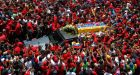 Man of the people: the coffin of Hugo Chávez is driven through the streets of Caracas this week. Photograph: Jorge Dan Lopez/Reuters