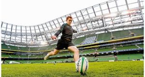 Ireland's Paddy Jackson gets in some place-kicking practice during the Captain's Run at the Aviva Stadium yesterday. photograph: billy stickland/inpho