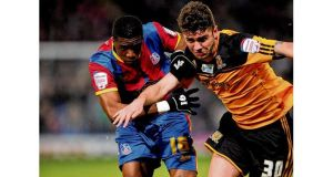 "Hull City's Robbie Brady battles Wilfred Zaha of Crystal Palace during Tuesday night's Championship match. Coach Steve Bruce said it was ""of paramount importance"" Brady was signed by the club.photograph: getty images"