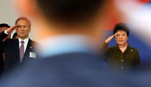South Korean president Park Geun-hye and defence minister Kim Kwan-jin salute at a ceremony for 5,780 military officers in Gyeryong today. South Korea is most at risk from North?s artillery and rockets. Photograph: Ahn Jeong-won/Yonhap/Reuters