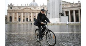 French Cardinal Philippe Barbarin rides his bicycle through St Peter's Square in the Vatican after a meeting at the Synod Hall. Photograph: Max Rossi/Reuters