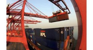 A crane loads containers at a port in Lianyungang in China's Jiangsu province.  Photograph: China Daily/Reuters.