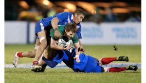 Ireland's Rory Scannell tackled by Mathieu Babillot and Enzo Selponi of France. Photograph: James Crombie/Inpho