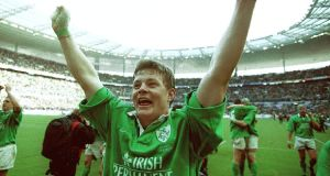 Celebrating after his famous hat-trick of tries helped to achieve a rare Ireland win in Paris, in March 2000.