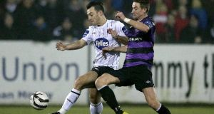 Dundalk's Richie Towell and Ronan Finn of Shamrock Rovers battle for possession at Oriel Park last night. Photograph: Inpho