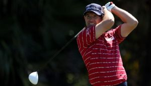 Pádraig Harrington tees off yesterday in the second round of the WGC-Cadillac Championship at Doral. Photograph: Warren Little/Getty