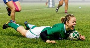 Ireland's fullback Niamh Briggs goes over the French line to score a try during last night's Women's Six Nations Championship clash at Ashbourne RFC. Photograph: Dan Sheridan/Inpho