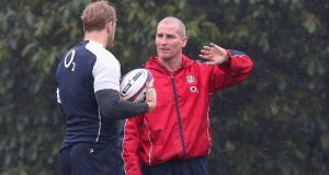 Stuart Lancaster (right) the England head coach talks to his captain Chris Robshaw. Photograph: David Rogers/Getty Images