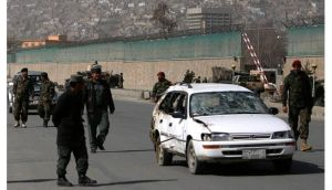 Afghan soldiers remove a damaged car from the site of a suicide attack in Kabul this morning. Photograph:  Mohammad Ismail`/Reuters