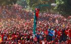 A supporter of Kenya's deputy prime minister and presidential candidate Uhuru Kenyatta stands on a street lamp at the last campaign rally in the Uhuru Park grounds in the capital Nairobi. Photograph: Marko Djurica/Reuters