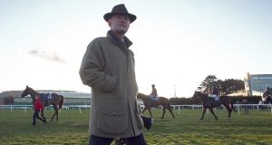 Trainer Willie Mullins with his string at last Sunday's pre-Cheltenham schooling after racing at Leopardstown racecourse. Photograph: Donall Farmer/Inpho