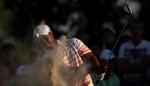 Tiger Woods plays out of the 15th greenside bunker at Doral. Photograph: Warren Little/Getty Images