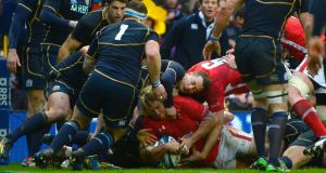 Richard Hibbard scores a try for Wales against Scotland at Murrayfield. Photograph: Russell Cheyne/Reuters