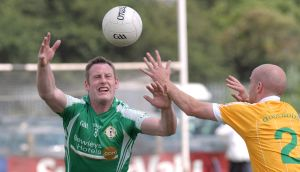 London's Lorcan Mulvey with Anto Healy of Antrim during the qualifiers last year.