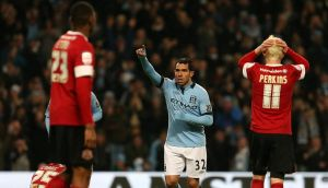 Manchester City's Carlos Tevez celebrates his hat-trick. Photograph: Dave Thompson/PA Wire.