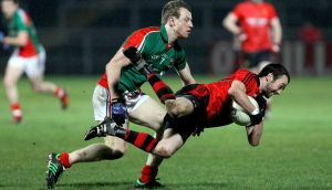 Down's Conor Laverty is challenged by  Mayo's Colm Boyle. Photograph: William Cherry/Inpho