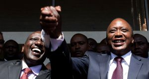President-elect Uhuru Kenyatta (right) greets his supporters with his running mate, former cabinet minister William Ruto after he was declared winner of Kenya's presidential election with a tiny margin. Photograpg: Reuters