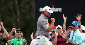 Graeme McDowell celebrates his eagle on the 16th greenat Doral. Photograph: Warren Little/Getty Images