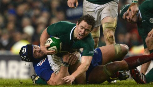 Eoin Reddan is tackled by Christophe Samson  late in  the game. Reddan was taken off late in the game with a broken leg. Photograph: Cyril Byrne/The Irish Times