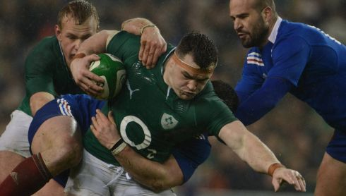 Cian Healy charges forward against France and Frederic Michalak. Photograph: Cyril Byrne/The Irish Times