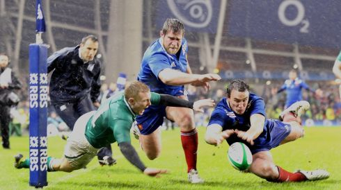 Keith Earls with Florian Fritz. Photograph: Dan Sheridan/Inpho