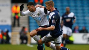 Leon Best of Blackburn holds off the challenge of Millwall's Mark Beevers. Photograph:  Andrew Winning/Reuters