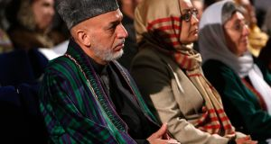 Afghan president Hamid Karzai sits during an event to mark International Women's Day in Kabul today. Photograph: Mohammad Ismail/Reuters