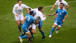 Toby Flood runs into Italy's Gonzalo Canale and Sergio Parisse at Twickenham. Photograph: Mike Hewitt/Getty Images