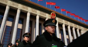 Soldiers marching outside the Great Hall of the People in Beijing, where a session of the National People's Congress is being held. Photograph: Feng Li/Getty Images