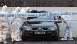 Gardaí examine a car at the scene of the murder of Peter Butterly at the Huntsman Inn near Gormanstown Co Meath on Wednesday.  Photograph: Laura Hutton/Photocall Ireland