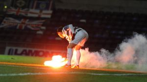 Flares are thrown onto the pitch at  Windsor park in Belfast. Photograph:  Pacemaker Press