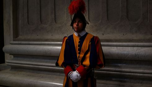 A Swiss Guard stands near the entrance of St Peter's Basilica during the Pro Eligendo Romano Pontifice Mass in Rome today.  Photograph:  Spencer Platt/Getty Images