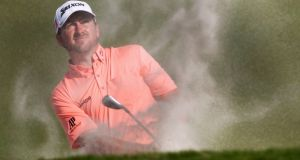 Graeme McDowell of Northern Ireland hits out of a sand trap on the 10th hole during final round play in the 2013 WGC-Cadillac Championship PGA golf tournament in Doral, Florida March 10, 2013. REUTERS/Andrew Innerarity (UNITED STATES  - Tags: SPORT GOLF)