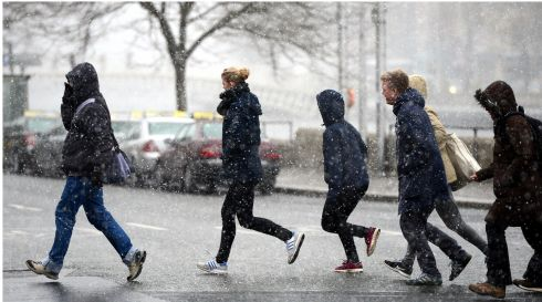 Crossing the snowy quays in Dublin. Photograph: Bryan O'Brien/The Irish Times