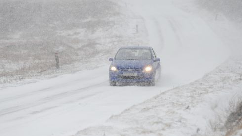 A motorist drives on a snow covered road as brief but heavy snow storms move across the Yorkshire Moors. Photograph:  Jordan Mansfield/Getty Images