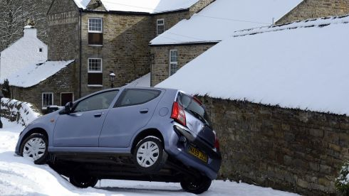 A car balances on 2 wheels after misjudging a corner in  Northumberland. Photograph: Owen Humphreys/PA Wire