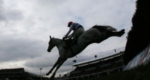 Barry Geraghty on Simonsig jumps the last fence to go on and win the Arkle Challenge Trophy Steeple Chase. Photograph: Stefan Wermuth/Reuters