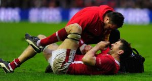 Ryan Jones of Wales receives treatment during the match against Scotland. Photograph: Stu Forster/Getty Images
